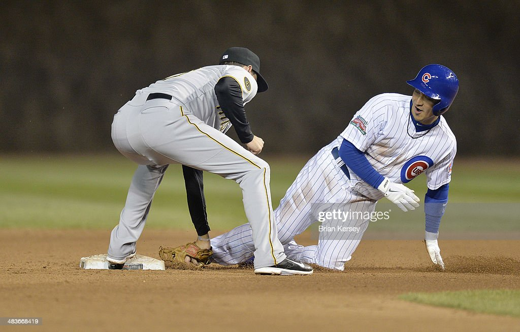 Shortstop Jordy Mercer #10 of the Pittsburgh Pirates (L) tags out <a gi-track='captionPersonalityLinkClicked' href=/galleries/search?phrase=Darwin+Barney&family=editorial&specificpeople=537975 ng-click='$event.stopPropagation()'>Darwin Barney</a> #15 of the Chicago Cubs at second base after Ryan Kalish #51 hit into a double play during the seventh inning at Wrigley Field on April 9, 2014 in Chicago, Illinois.