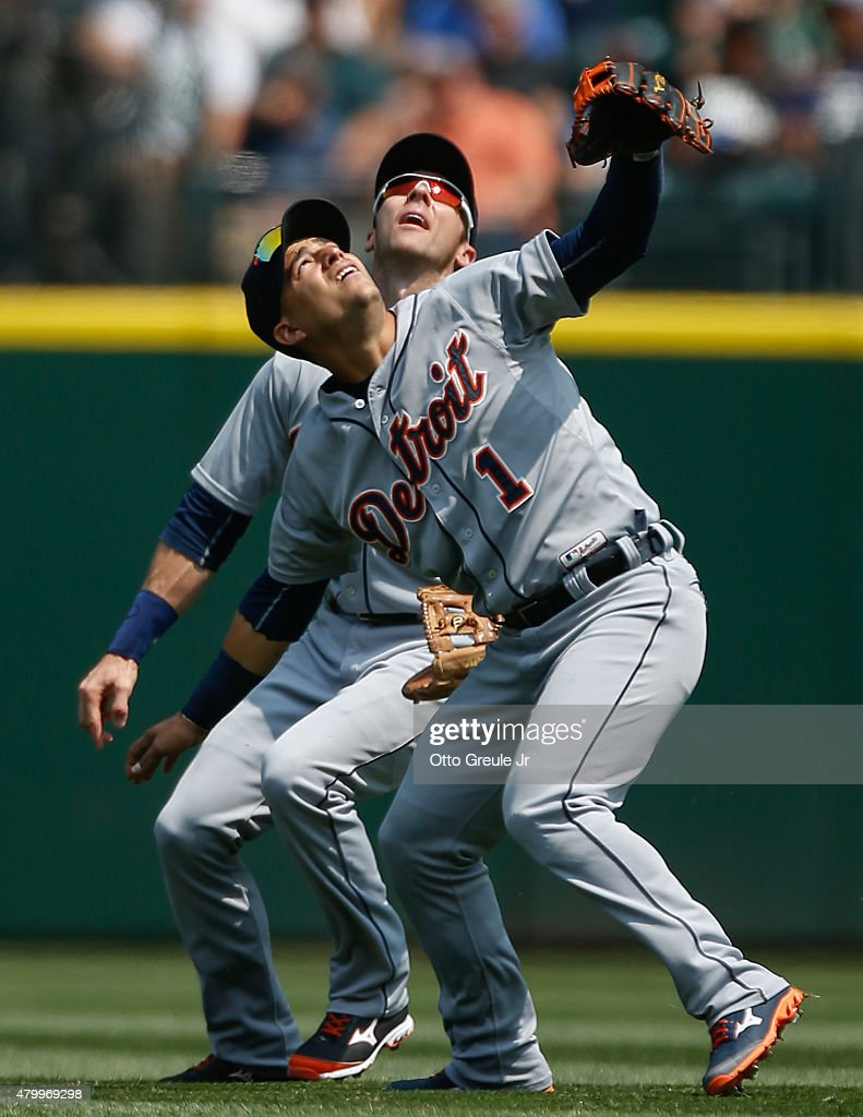 Shortstop Jose Iglesias #1 and second baseman <a gi-track='captionPersonalityLinkClicked' href=/galleries/search?phrase=Andrew+Romine&family=editorial&specificpeople=2338123 ng-click='$event.stopPropagation()'>Andrew Romine</a> #27 of the Detroit Tigers position themselves for a pop fly off the bat of Kyle Seager of the Seattle Mariners in the fourth inning at Safeco Field on July 8, 2015 in Seattle, Washington. The Tigers defeated the Mariners 5-4.