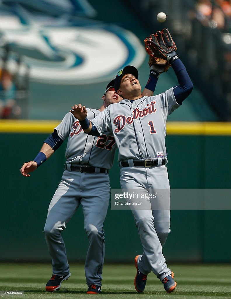 Shortstop Jose Iglesias #1 and second baseman <a gi-track='captionPersonalityLinkClicked' href=/galleries/search?phrase=Andrew+Romine&family=editorial&specificpeople=2338123 ng-click='$event.stopPropagation()'>Andrew Romine</a> #27 of the Detroit Tigers position themselves for a pop fly off the bat of Kyle Seager of the Seattle Mariners in the fourth inning at Safeco Field on July 8, 2015 in Seattle, Washington. Iglesias made the catch, and the Tigers went on to defeat the Mariners 5-4.