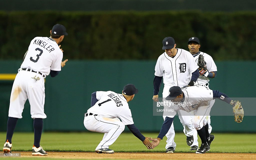 Shortstop Jose Iglesias #1 and teammate <a gi-track='captionPersonalityLinkClicked' href=/galleries/search?phrase=Rajai+Davis&family=editorial&specificpeople=810608 ng-click='$event.stopPropagation()'>Rajai Davis</a> #20 of the Detroit Tigers celebrate a win over the New York Yankees at Comerica Park on April 20, 2015 in Detroit, Michigan. The Tigers defeated the Yankees 2-1.