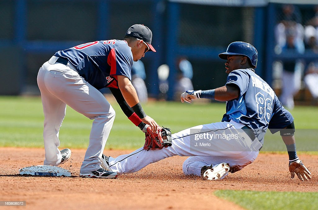 Shortstop Jose Iglesias #10 of the Boston Red Sox tags out outfielder Leslie Anderson #86 of the Tampa Bay Rays as he attempted to advance to second during a Grapefruit League Spring Training Game at the Charlotte Sports Complex on March 16, 2013 in Port Charlotte, Florida.