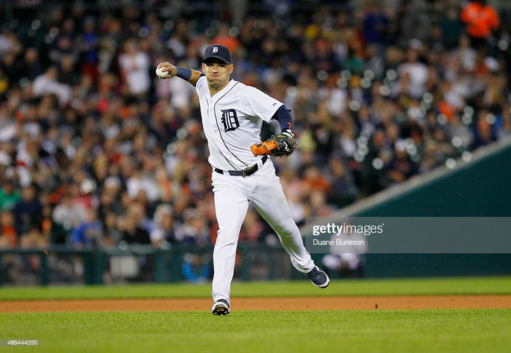 Shortstop Jose Iglesias #1 of the Detroit Tigers throws out Albert Pujols of the Los Angeles Angels of Anaheim at first base on a ground ball during the fourth inning at Comerica Park on August 25, 2015 in Detroit, Michigan.