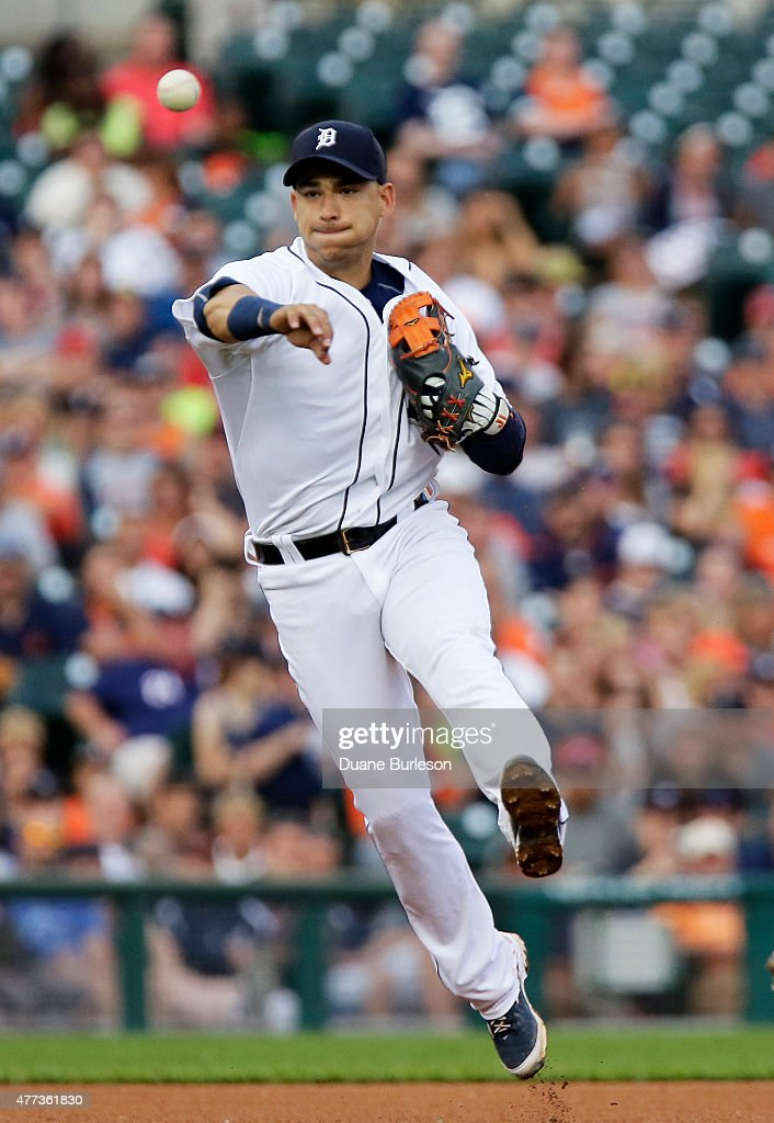 Shortstop Jose Iglesias #1 of the Detroit Tigers throws out Brayan Pena #29 of the Cincinnati Reds at first base on a grounder during the fifth inning at Comerica Park on June 16, 2015 in Detroit, Michigan.