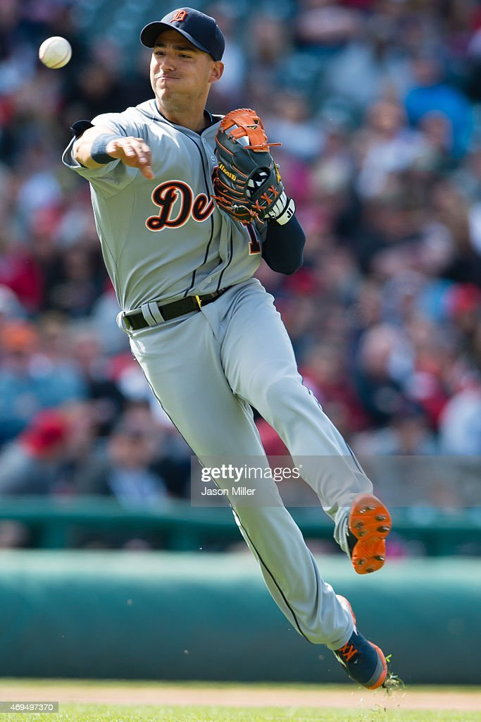 Shortstop Jose Iglesias #1 of the Detroit Tigers throws out Jerry Sands #40 at first to end the seventh inning at Progressive Field on April 12, 2015 in Cleveland, Ohio.