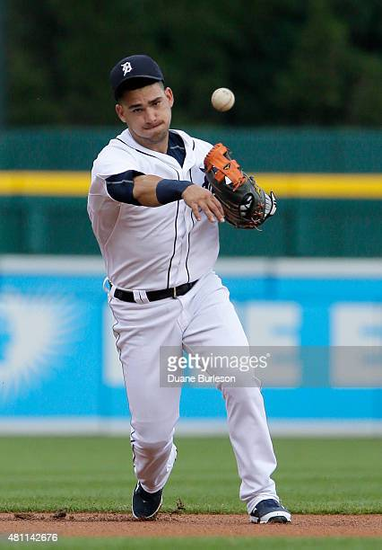 Shortstop Jose Iglesias of the Detroit Tigers throws out Manny Machado of the Baltimore Orioles at first base on a grounder during the first inning...