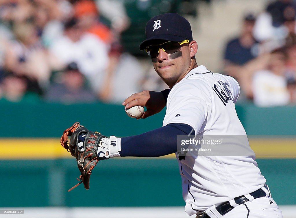 Shortstop Jose Iglesias #1 of the Detroit Tigers throws out Mike Napoli the Cleveland Indians at first base on a grounder during the eighth inning at Comerica Park on June 25, 2016 in Detroit, Michigan. The Indians defeated the Tigers 6-0.