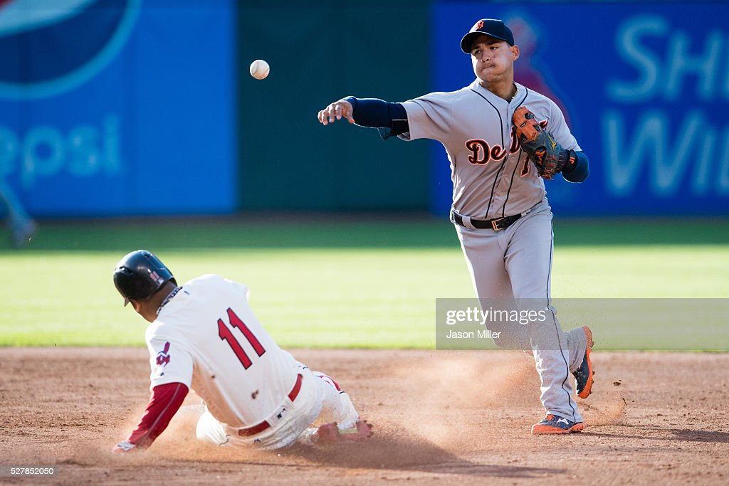 Shortstop Jose Iglesias #1 of the Detroit Tigers throws out Tyler Naquin #30 at first as Jose Ramirez #11 of the Cleveland Indians is out at second for a double play during the third inning at Progressive Field on May 3, 2016 in Cleveland, Ohio.