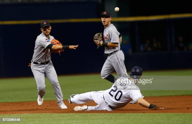 Shortstop Jose Iglesias of the Detroit Tigers throws to first base to turn a double play over Steven Souza Jr #20 of the Tampa Bay Rays to end the...