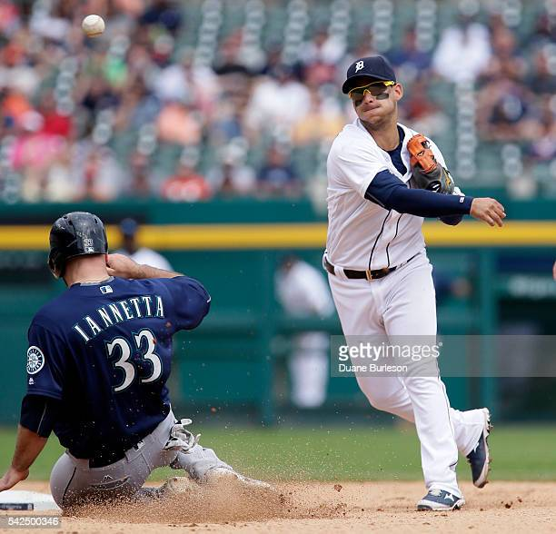 Shortstop Jose Iglesias of the Detroit Tigers turns the ball after getting a force out on Chris Iannetta of the Seattle Mariners during the ninth...