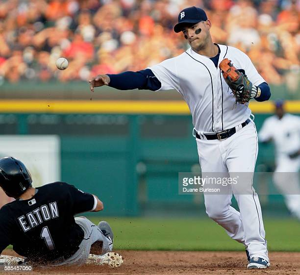 Shortstop Jose Iglesias of the Detroit Tigers turns the ball after getting a force out on Adam Eaton of the Chicago White Sox during the third inning...