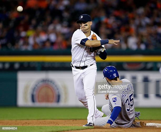 Shortstop Jose Iglesias of the Detroit Tigers turns the ball after getting a force out on Eric Hosmer of the Kansas City Royals during the sixth...