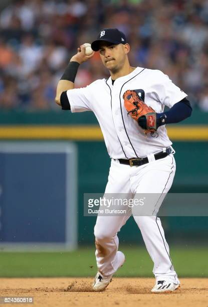 Shortstop Jose Iglesias of the Detroit Tigers turns the ball to complete a double play against the Houston Astros during the ninth inning at Comerica...