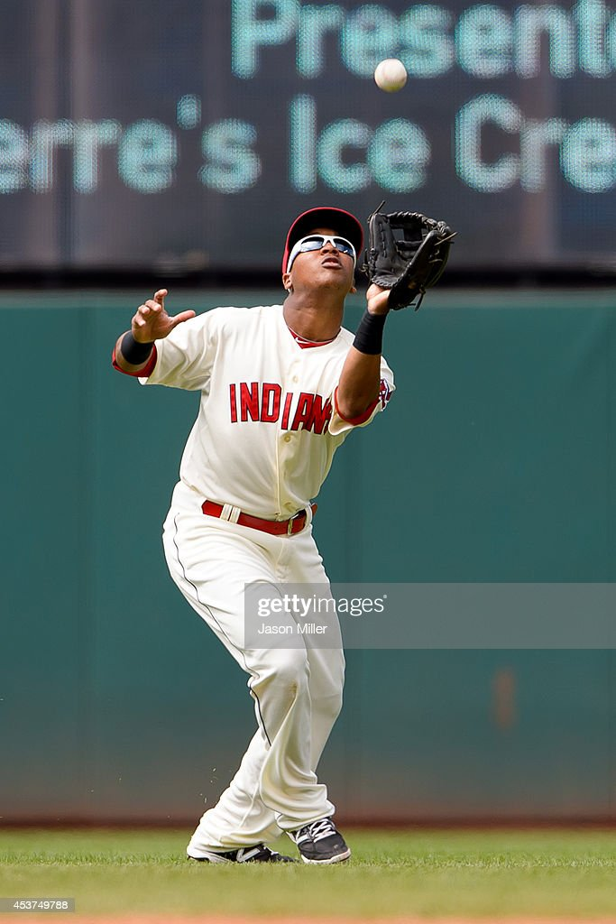 Shortstop Jose Ramirez #11 of the Cleveland Indians catches a fly ball hit by Nelson Cruz #23 of the Baltimore Orioles during the sixth inning at Progressive Field on August 17, 2014 in Cleveland, Ohio.