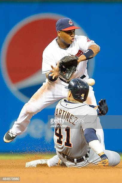 Shortstop Jose Ramirez of the Cleveland Indians catches the throw as Victor Martinez of the Detroit Tigers is safe at second on an error during the...
