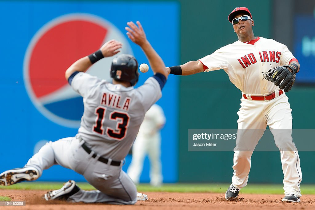 Shortstop Jose Ramirez #11 of the Cleveland Indians throws out Ezequiel Carrera #61 at first as <a gi-track='captionPersonalityLinkClicked' href=/galleries/search?phrase=Alex+Avila&family=editorial&specificpeople=5749211 ng-click='$event.stopPropagation()'>Alex Avila</a> #13 of the Detroit Tigers is out at second to end the top of the second inning a Progressive Field on September 1, 2014 in Cleveland, Ohio.
