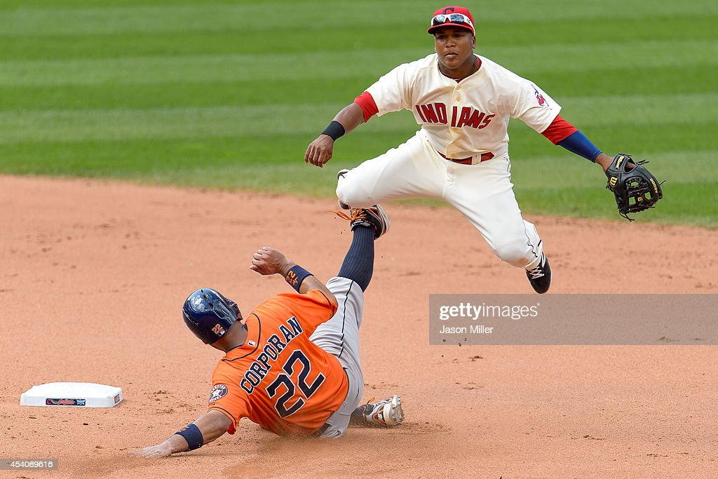 Shortstop Jose Ramirez #11 of the Cleveland Indians throws out Jason Castro #15 at first as Carlos Corporan #22 of the Houston Astros is out at second during the seventh inning at Progressive Field on August 24, 2014 in Cleveland, Ohio. The Indians defeated the Astros 3-1.