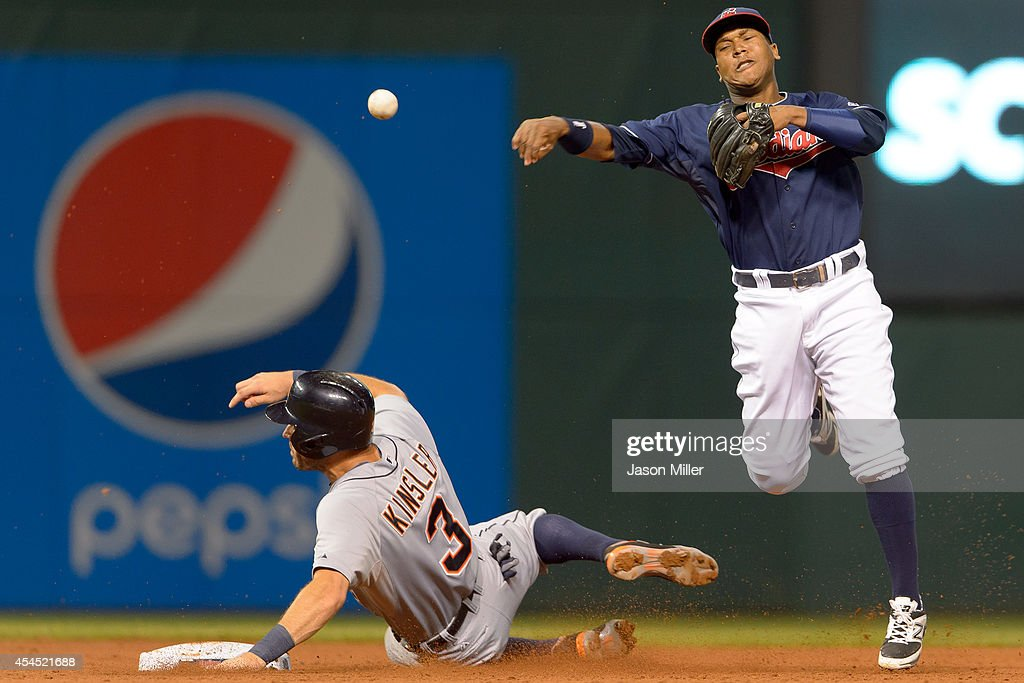 Shortstop Jose Ramirez #11 of the Cleveland Indians throws out Torii Hunter #48 at first as <a gi-track='captionPersonalityLinkClicked' href=/galleries/search?phrase=Ian+Kinsler&family=editorial&specificpeople=538104 ng-click='$event.stopPropagation()'>Ian Kinsler</a> #3 of the Detroit Tigers is out at second for a double play to end the top of the sixth inning at Progressive Field on September 2, 2014 in Cleveland, Ohio.