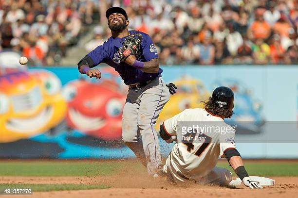 Shortstop Jose Reyes of the Colorado Rockies catches Jarrett Parker of the San Francisco Giants in a double play against Mac Williamson in the eighth...