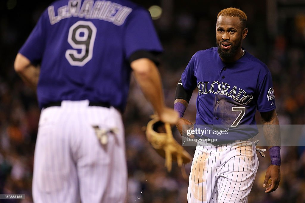 Shortstop <a gi-track='captionPersonalityLinkClicked' href=/galleries/search?phrase=Jose+Reyes+-+Baseball+Player&family=editorial&specificpeople=203307 ng-click='$event.stopPropagation()'>Jose Reyes</a> #7 of the Colorado Rockies collects his glove from second baseman <a gi-track='captionPersonalityLinkClicked' href=/galleries/search?phrase=DJ+LeMahieu&family=editorial&specificpeople=5940806 ng-click='$event.stopPropagation()'>DJ LeMahieu</a> #9 of the Colorado Rockies as they take the field against the Seattle Mariners during interleague play at Coors Field on August 3, 2015 in Denver, Colorado.