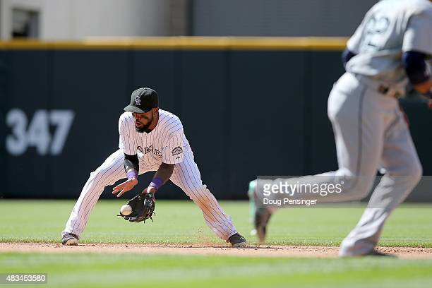 Shortstop Jose Reyes of the Colorado Rockies fields a ground ball and throws out the runner against the Colorado Rockies during interleague play at...