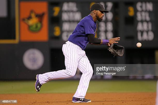Shortstop Jose Reyes of the Colorado Rockies fields a ground ball against the Pittsburgh Pirates at Coors Field on September 21 2015 in Denver...