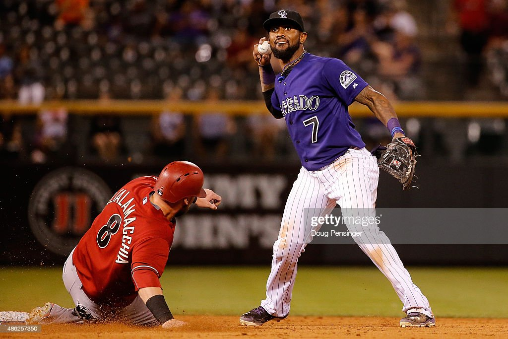 Shortstop <a gi-track='captionPersonalityLinkClicked' href=/galleries/search?phrase=Jose+Reyes+-+Baseball+Player&family=editorial&specificpeople=203307 ng-click='$event.stopPropagation()'>Jose Reyes</a> #7 of the Colorado Rockies gets a force out on <a gi-track='captionPersonalityLinkClicked' href=/galleries/search?phrase=Jarrod+Saltalamacchia&family=editorial&specificpeople=836404 ng-click='$event.stopPropagation()'>Jarrod Saltalamacchia</a> #8 of the Arizona Diamondbacks on a ground ball by Ender Inciarte #5 of the Arizona Diamondbacks that allowed Chris Owings #16 of the Arizona Diamondbacks to score and take a 4-3 lead in the sixth inning at Coors Field on September 2, 2015 in Denver, Colorado.