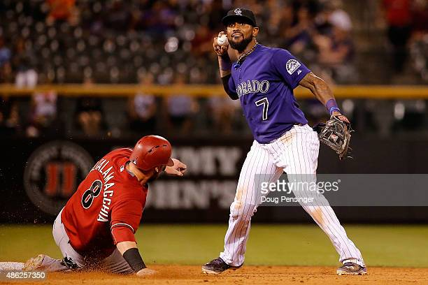 Shortstop Jose Reyes of the Colorado Rockies gets a force out on Jarrod Saltalamacchia of the Arizona Diamondbacks on a ground ball by Ender Inciarte...