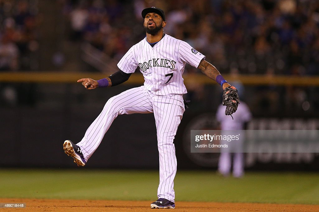 Shortstop <a gi-track='captionPersonalityLinkClicked' href=/galleries/search?phrase=Jose+Reyes+-+Baseball+Player&family=editorial&specificpeople=203307 ng-click='$event.stopPropagation()'>Jose Reyes</a> #7 of the Colorado Rockies reacts after throwing to first base to complete the double play for the first two outs of the fourth inning against the San Diego Padres at Coors Field on September 19, 2015 in Denver, Colorado.