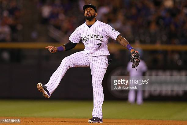 Shortstop Jose Reyes of the Colorado Rockies reacts after throwing to first base to complete the double play for the first two outs of the fourth...
