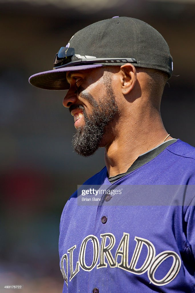 Shortstop <a gi-track='captionPersonalityLinkClicked' href=/galleries/search?phrase=Jose+Reyes+-+Baseball+Player&family=editorial&specificpeople=203307 ng-click='$event.stopPropagation()'>Jose Reyes</a> #7 of the Colorado Rockies smiles after throwing for a double play against the San Francisco Giants in the third inning at AT&T Park on October 4, 2015 in San Francisco, California, during the final day of the regular season. The Rockies won 7-3.