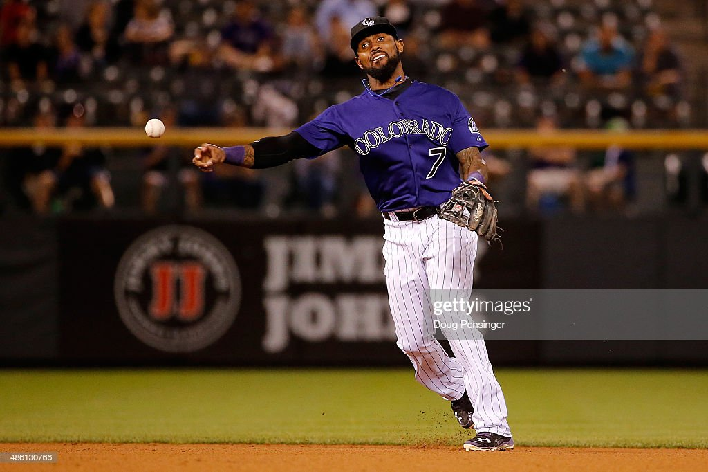 Shortstop <a gi-track='captionPersonalityLinkClicked' href=/galleries/search?phrase=Jose+Reyes+-+Baseball+Player&family=editorial&specificpeople=203307 ng-click='$event.stopPropagation()'>Jose Reyes</a> #7 of the Colorado Rockies throws out a runner against the Arizona Diamondbacks at Coors Field on August 31, 2015 in Denver, Colorado. The Rockies defeated the Diamondbacks 5-4.