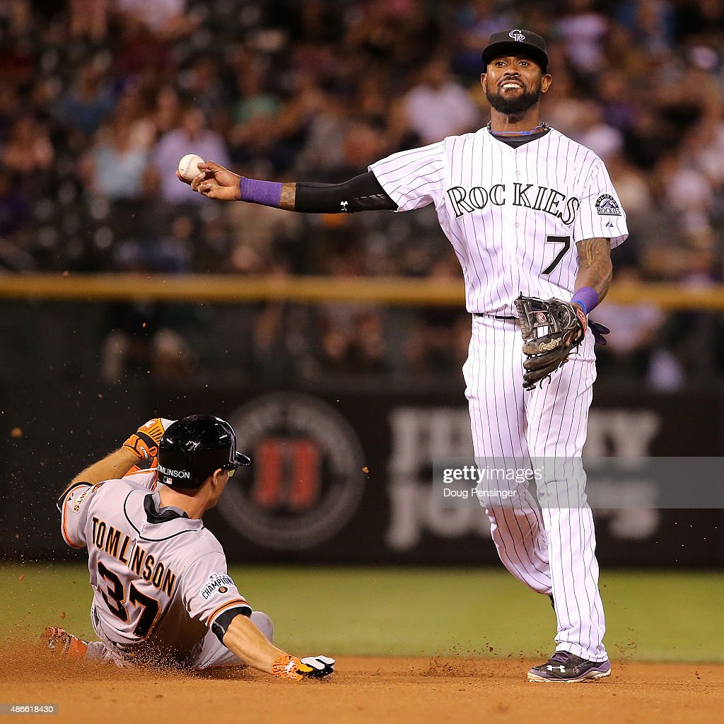 Shortstop <a gi-track='captionPersonalityLinkClicked' href=/galleries/search?phrase=Jose+Reyes+-+Baseball+Player&family=editorial&specificpeople=203307 ng-click='$event.stopPropagation()'>Jose Reyes</a> #7 of the Colorado Rockies turns a double play on <a gi-track='captionPersonalityLinkClicked' href=/galleries/search?phrase=Kelby+Tomlinson&family=editorial&specificpeople=7682512 ng-click='$event.stopPropagation()'>Kelby Tomlinson</a> #37 of the San Francisco Giants in the seventh inning at Coors Field on September 4, 2015 in Denver, Colorado.