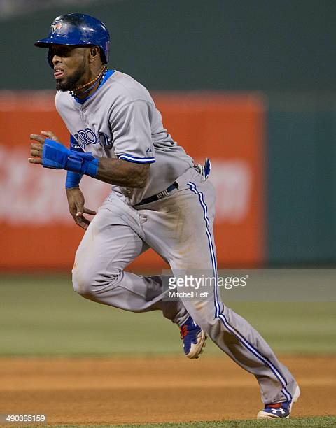Shortstop Jose Reyes of the Toronto Blue Jays runs to third base against the Philadelphia Phillies on May 5 2014 at Citizens Bank Park in...