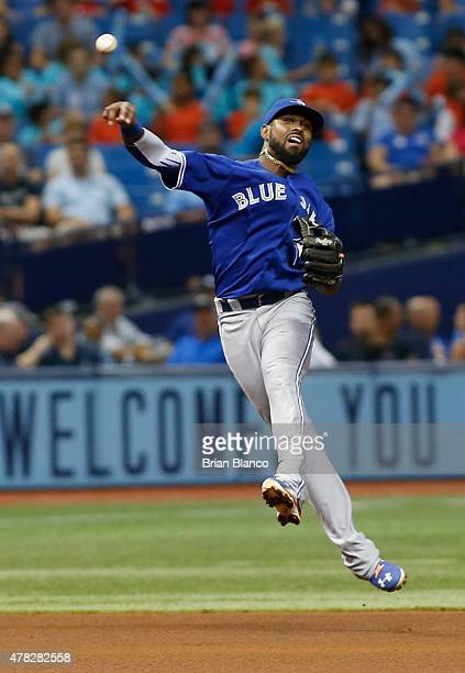 Shortstop Jose Reyes of the Toronto Blue Jays throws out Joey Butler of the Tampa Bay Rays at first base during the fourth inning of a game on June...