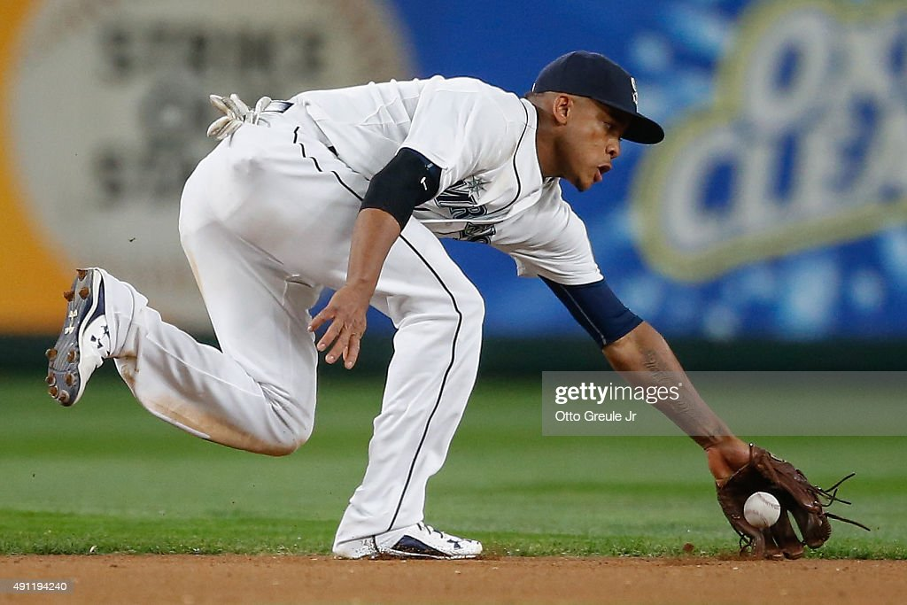 Shortstop Ketel Marte of the Seattle Mariners just misses fielding a grounder off the bat of Brett Lawrie of the Oakland Athletics in the fourth...