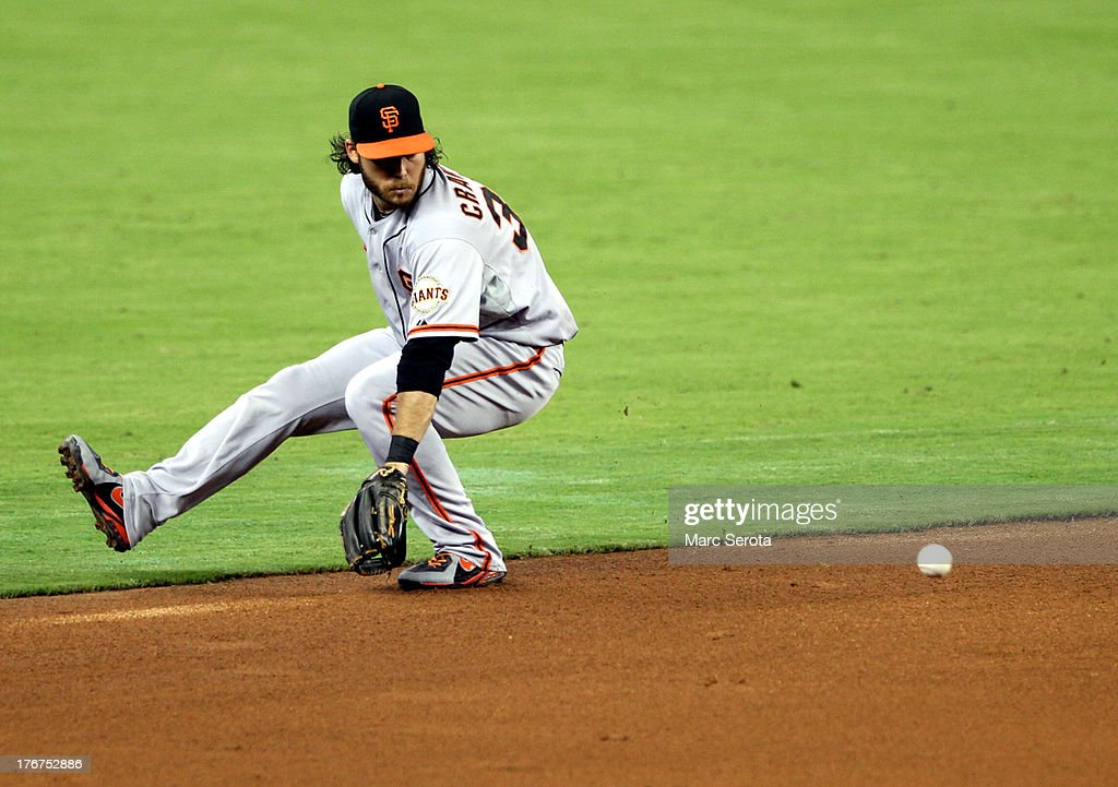 Shortstop <a gi-track='captionPersonalityLinkClicked' href=/galleries/search?phrase=Marco+Scutaro&family=editorial&specificpeople=239523 ng-click='$event.stopPropagation()'>Marco Scutaro</a> #19 of the San Francisco Giants fields a ground ball against the Miami Marlins at Marlins Park on August 18, 2013 in Miami, Florida.
