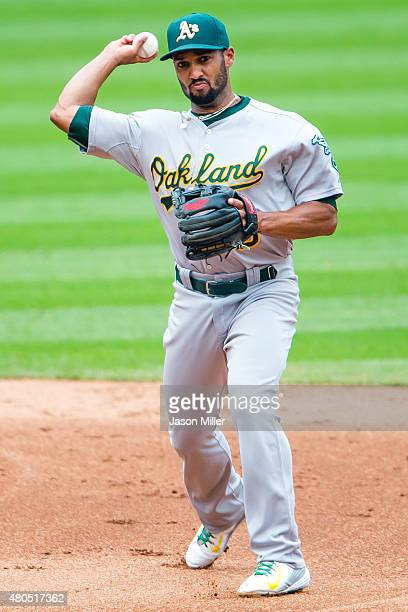 Shortstop Marcus Semien of the Oakland Athletics throws out Giovanny Urshela of the Cleveland Indians at first during the third inning at Progressive...