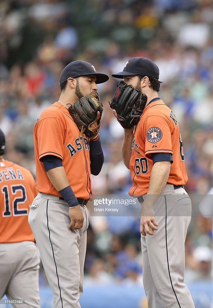 Shortstop Marwin Gonzalez #9 of the Houston Astros talks with starting pitcher Dallas Keuchel #60 during the third inning against the Chicago Cubs at Wrigley Field on June 21, 2013 in Chicago, Illinois.