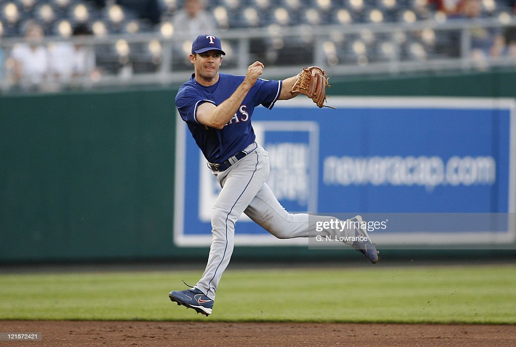 Shortstop Michael Young of the Rangers throws to make an out during action between the Texas Rangers and Kansas City Royals at Kauffman Stadium in...