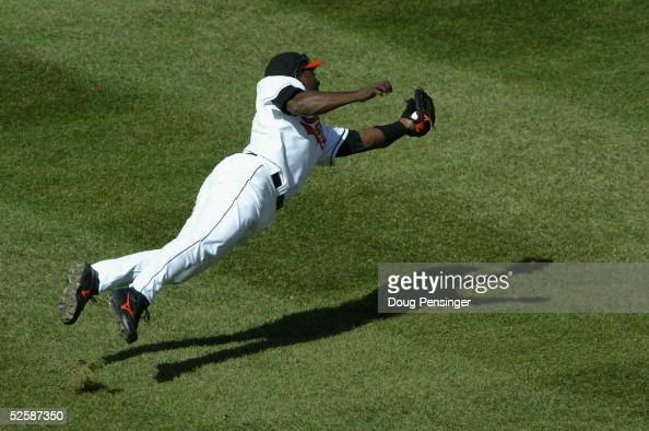 Shortstop Miguel Tejada of the Baltimore Orioles dives to make a catch on a pop up by Nick Swisher of the Oakland Athletics to end the second inning...
