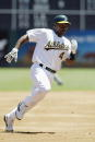 Shortstop Miguel Tejada of the Oakland Athletics runs to third base on designated hitter's Erubiel Durazo double against the Tampa Bay Devil Rays...