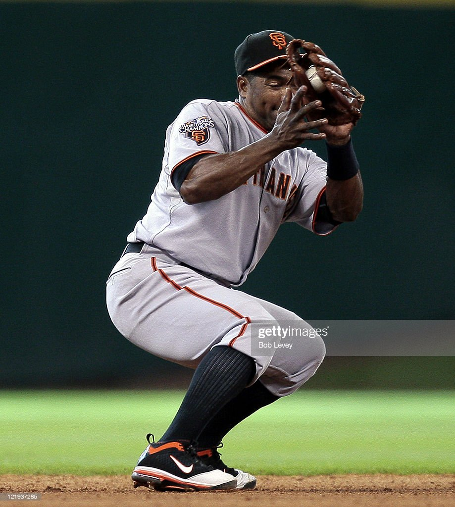 Shortstop Miguel Tejada #10 of the San Francisco Giants makes a catch on a line drive against the Houston Astros at Minute Maid Park on August 21, 2011 in Houston, Texas. San Francisco won 6-4.