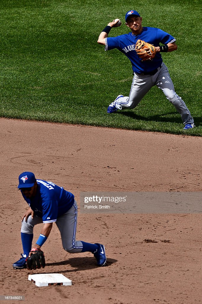 Shortstop <a gi-track='captionPersonalityLinkClicked' href=/galleries/search?phrase=Munenori+Kawasaki&family=editorial&specificpeople=690355 ng-click='$event.stopPropagation()'>Munenori Kawasaki</a> #66 of the Toronto Blue Jays makes a play against the Baltimore Orioles in the ninth inning at Oriole Park at Camden Yards on April 24, 2013 in Baltimore, Maryland. The Toronto Blue Jays won, 6-5.