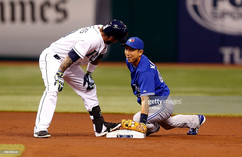 Shortstop <a gi-track='captionPersonalityLinkClicked' href=/galleries/search?phrase=Munenori+Kawasaki&family=editorial&specificpeople=690355 ng-click='$event.stopPropagation()'>Munenori Kawasaki</a> #66 of the Toronto Blue Jays smiles at baserunner Ryan Roberts #19 of the Tampa Bay Rays during the game at Tropicana Field on May 7, 2013 in St. Petersburg, Florida.