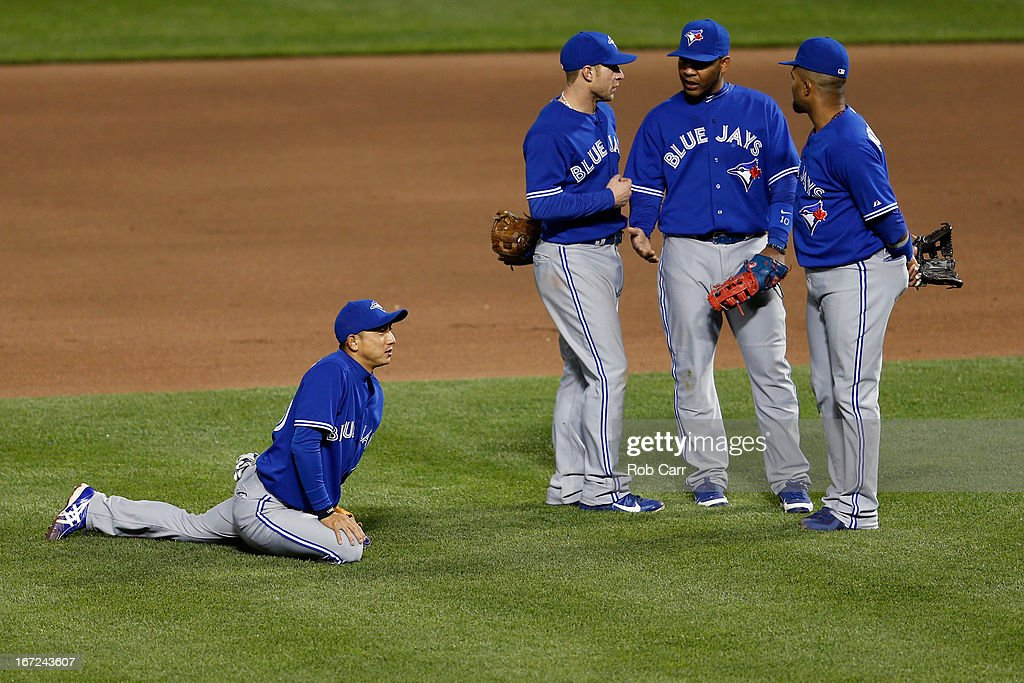 Shortstop <a gi-track='captionPersonalityLinkClicked' href=/galleries/search?phrase=Munenori+Kawasaki&family=editorial&specificpeople=690355 ng-click='$event.stopPropagation()'>Munenori Kawasaki</a> #66 of the Toronto Blue Jays stretches during a pitching change against the Baltimore Orioles at Oriole Park at Camden Yards on April 22, 2013 in Baltimore, Maryland.