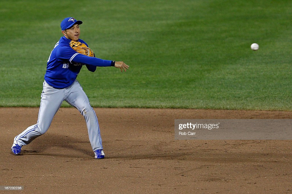 Shortstop <a gi-track='captionPersonalityLinkClicked' href=/galleries/search?phrase=Munenori+Kawasaki&family=editorial&specificpeople=690355 ng-click='$event.stopPropagation()'>Munenori Kawasaki</a> #66 of the Toronto Blue Jays throws to second base to force out a Baltimore Orioles runner during the seventh inning at Oriole Park at Camden Yards on April 22, 2013 in Baltimore, Maryland.