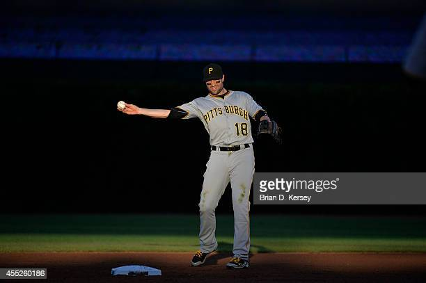 Shortstop Neil Walker of the Pittsburgh Pirates warms up before the sixth inning against the Chicago Cubs at Wrigley Field on September 6 2014 in...