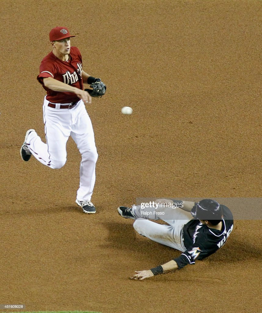 Shortstop Nick Ahmed #13 of the Arizona Diamondbacks throws over <a gi-track='captionPersonalityLinkClicked' href=/galleries/search?phrase=Christian+Yelich&family=editorial&specificpeople=9527291 ng-click='$event.stopPropagation()'>Christian Yelich</a> #21 of the Miami Marlins to complete a double play during the first inning of a MLB game at Chase Field on July 9, 2014 in Phoenix, Arizona.