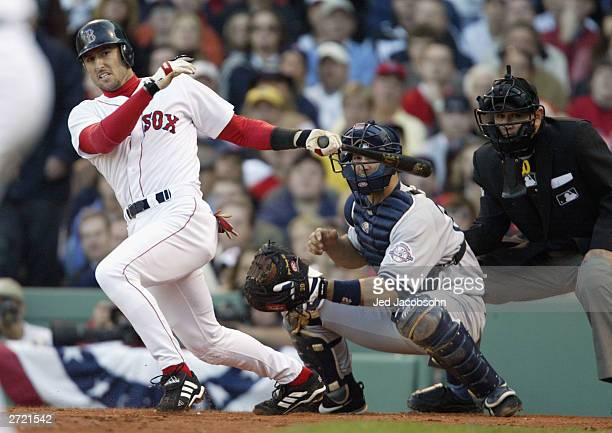 Shortstop Nomar Garciaparra of the Boston Red Sox connects with a New York Yankees pitch during Game 3 of the 2003 American League Championship...