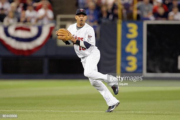 Shortstop Orlando Cabrera of the Minnesota Twins fields the ball during the 9th inningof the American League Tiebreaker game against the Detroit...